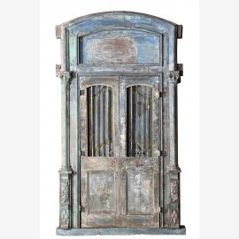 Powerful wooden door with elaborate arch and frame