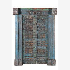 Wooden carved blue door with solid frame