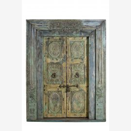 Pakistani door with noble ornaments and blue frame