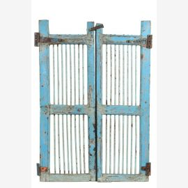 Light blue lacquered teak door that can serve as a bar door