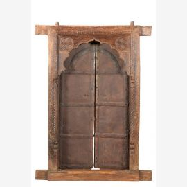 Solid wooden door with elaborate carvings and curved door frames