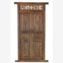 Wooden door with carvings and decorated frame