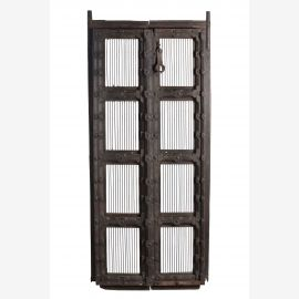 Woodworked door with iron grating elements