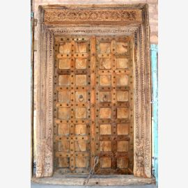 Natural wooden door from India with simple carvings.