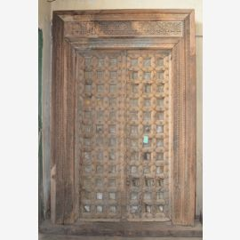 Indian door made of robust wood refined with carvings.