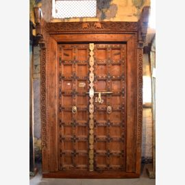 Solid wood door from India refined with high-quality carvings.