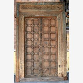 Natural wood door from India with carvings refined.