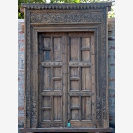 Indian solid wood door in dark wood. Carvings.