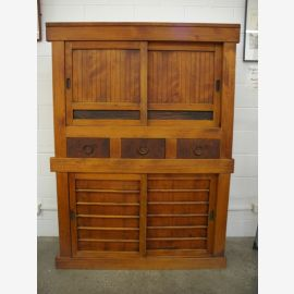 Japanese cabinet from real wood in warm wood optics with carvings