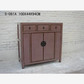Noble wooden cabinet from China kept in grey.
