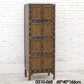 Solid wood cabinet from Tibet with carvings in muted colours