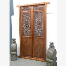 The Chinese door made of light solid wood with elaborate details