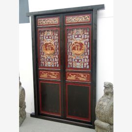 The real wood door from China was decorated with traditional elements.