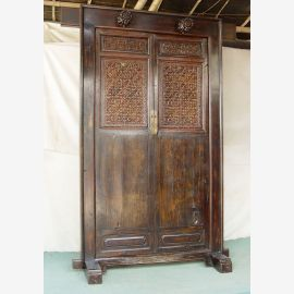The solid wood door from China is held in dark wood and decorated with carvings