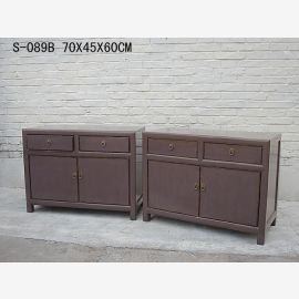 Chinese double cupboard made of solid wood in used look.