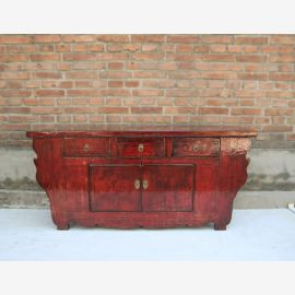Chinese sideboard made of solid wood in expressive red.