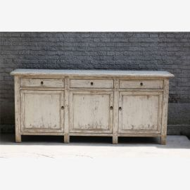 Modern cupboard made of hardwood in ivory in used look with clasps