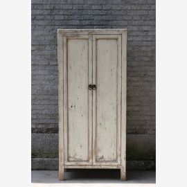 Modern cupboard made of real wood in ivory in used look with clasps