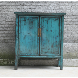 Asian cabinet made of natural wood in modern turquoise with applications