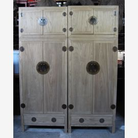 Real wood cabinet from Asia in used look with metal applications.