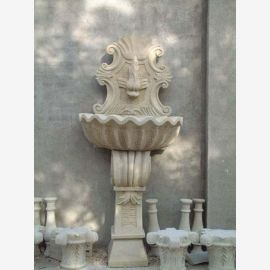 Antique wall fountain on base semicircular shell white marble