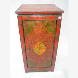 Tibet cabinet in traditional design in red and green. natural wood
