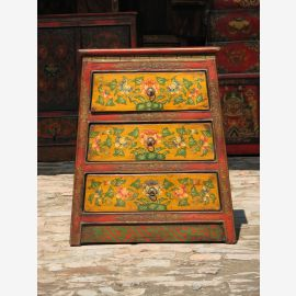 Tibetan drawer cabinet made of solid wood in vintage look with classic motif.