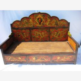 The Tibet bed frame is richly decorated and made of solid wood.