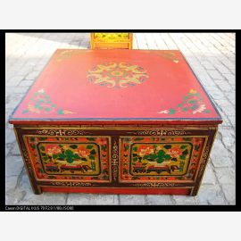 Solid wood table with Tibetan painting in strong colours.