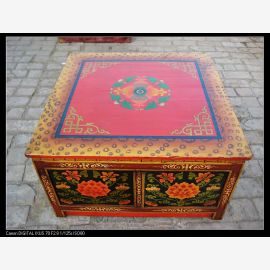 Solid wood table from Tibet with elaborate decoration in expressive colours.